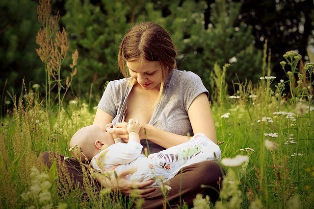 mother breastfeeding outdoors
